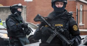 Armed gardaí from the Emergency Response Unit on patrol in Dublin after the recent gangland murders. Photograph: Niall Carson/PA Wire