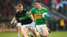 Michael Quinlivan of Clonmel Commercials in action against Nemo Rangers' Aidan O'Reilly during the AIB Munster Club Senior Football Championship Final in Mallow. Photograph:  James Crombie/Inpho