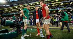 Dan Biggar (centre) talks to Jamie Heaslip and   Jonathan Davies after last Sunday's Six Nations game in Dublin. Photograph:  James Crombie/Inpho