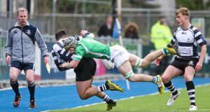 Gonzaga's Jack MacNamara tackles Daniel Keane of Roscrea during the Bank of Ireland Leinster Schools Senior Cup quarter-final at Donnybrook. Photograph: Gary Carr/Inpho
