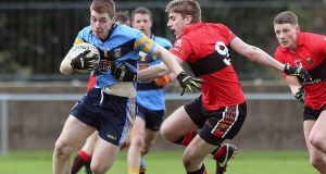 UCD's Barry O'Sullivan gets past Ian Maguire of UCC at the Mardyke. Photograph: Lorraine O'Sullivan/Inpho.