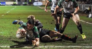 Connacht's Eoghan Masterson stretches to score his side's  third try during the Guinness Pro 12 game at Rodney Parade. Photograph:  Craig Thomas/Inpho