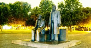 A statue of Marx and Engels in Berlin: the wakening of Engels's class consciousness was aided by his love affair with a poor Irish worker, Mary Burns, and later her sister Lizzie, subject of Gavin McCrea's novel, Mrs Engels
