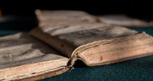 A damaged book at Bolton Library, Cashel, Co Tipperary. Photograph: Alan Place/Fusionshooters