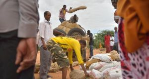 Displaced: traders unload a truck at Dadaab. Photograph: Tony Karumba/AFP/Getty