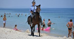 Armed police on horseback patrol Marhaba beach in June where 38 people were killed in a terrorist attack in Sousse, Tunisia. File photograph: Jeff J Mitchell/Getty Images
