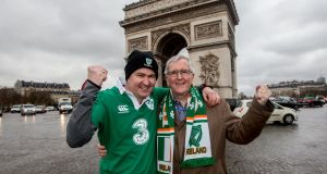 Fergal Duffy from Navan, Co Meath with his father Jim Duffy, Rathfarnham, Dublin, at the Arc de Triomphe ahead of Ireland's clash with France. Photograph: James Crombie/Inpho