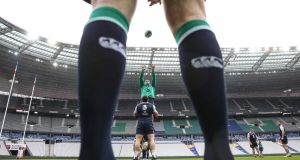 Ireland flanker Seán O'Brien rises high to collect Rory Best's lineout delivery during yesterday's captain's run at the Stade de France, which will be a 79,000 sell-out for the teams' Six Nations clash. Photograph: Billy Stickland/Inpho