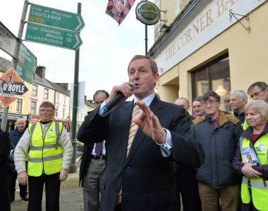 Taoiseach Enda Kenny on the main street of Ballyhaunis, Co Mayo, during a general election canvassing stop. Photograph: Alan Betson