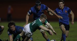 Ireland's scrum-half Stephen Kerins under pressure during his side's defeat to France. Photograph: AFP