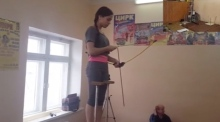 Russian teen shoots bow and arrow with feet while standing on her hands
