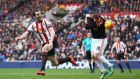 John O'Shea of Sunderland and Wayne Rooney of Manchester United compete for the ball at the Stadium of Light. Photograph: Clive Brunskill/Getty Images