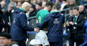 Ireland's Dave Kearney goes off injured in Paris. Photograph: Dan Sheridan/Inpho