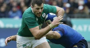 Robbie Henshaw is tackled during the Six Nations defeat to France at the Stade de France Stadium on Saturday. Photograph: Getty Images