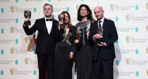 John Crowley, Finola Dwyer, Amanda Posey and Nick Hornby pose in the press room after winning the award for Outstanding British Film for Brooklyn during the 69th Baftas  in London, England. Photograph: Andy Rain/EPA