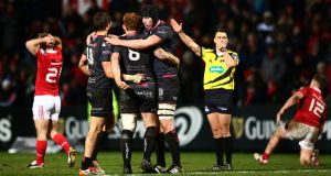 Ospreys players celebrate at the final whistle after beating Munster at Musgrave Park. Photo: James Crombie/Inpho