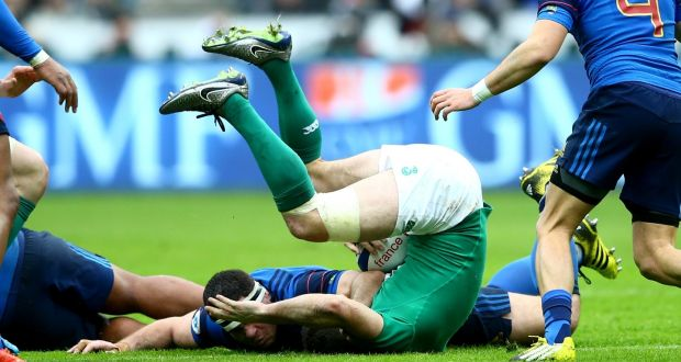 Ireland's Dave Kearney is taken out by a high tackle from France's Guilhelm Guirado during the sides' Six Nations clash at Stade de France. Photo: James Crombie/Inpho