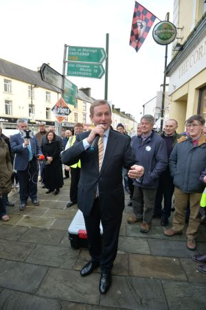 Taoiseach Enda Kenny on the main street of Ballyhaunis Co. Mayo  during a general Election canvassing stop.  Photograph: Alan Betson / The Irish Times