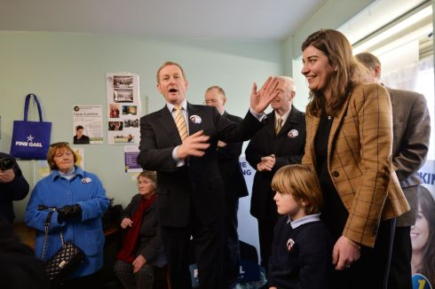 Taoiseach Enda Kenny with Election Candidate Maura Hopkins (Right)  during a general Election canvassing stop at Ballaghaderreen Co. Roscommon.  Photograph: Alan Betson / The Irish Times