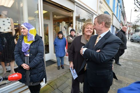 Taoiseach Enda Kenny meeting his wife Fionnuala O'Kelly  on the main street of Ballyhaunis Co. Mayo  during a general Election canvassing stop.  Photograph: Alan Betson / The Irish Times