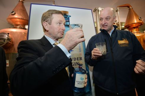 Taoiseach Enda Kenny with Pat J Rigney Owner  of  the Shed Distillery sampling some Gunpowder Irish Gin brewed  at  the Food Hub  in Drumshambo, Co. Leitrim during a general Election canvassing stop. Photograph: Alan Betson / The Irish Times