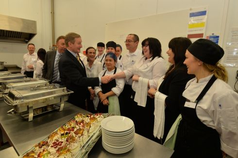 Taoiseach Enda Kenny speaks to catering staff at the Community Kitchen in  the Food Hub  in Drumshambo, Co. Leitrim during a general Election canvasing stop.  Photograph: Alan Betson / The Irish Times