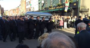 Pallbearers carry David Byrne's coffin into St Nicolas of Myra church on, Francis Street, Dublin 8, for his funeral.