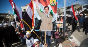 Druze men from the village of Buqatat carry a picture of Syrian president Bashar al-Assad during a rally in support of the Syrian regime at the weekend. Photograph: Atef Safadi/EPA