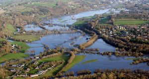 River Lee flows towards Cork city following flooding in 2009. Photograph: Michael MacSweeney/Provision