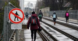 People walking the Luas line near Milltown, last week during the first planned two-day stoppage as a result of strike action. Photograph: Cyril Byrne/The Irish Times