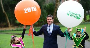 Minister for Transport, Tourism and Sport, Paschal Donohoe  at the launch of the St Patrick's Festival 2016 with festival parade characters, Ciara Withington (6) and James MacDougald (8) in Merrion Sq, Dublin.Photograph: Dara Mac Dónaill/The Irish Times