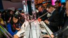 Visitors sample Motorola devicces at last year's Mobile World Congress in Barcelona. Photograph: David Ramos/Getty Images