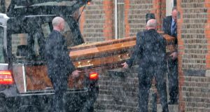 The remains of Eddie Hutch, who was shot dead in his home in Dublin last week, are brought to his sister's home on Portland Row on Wednesday evening under a heavy Garda presence. Photograph: Colin Keegan/Collins.