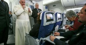 Pope Francis speaks to journalists aboard a flight from Mexico to Italy. Photograph: Alessandro Di Meo/AFP/Getty Images