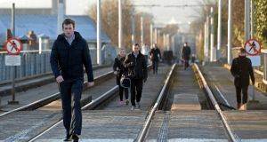 Commuters take to the tracks and walk along the line at Ranelagh. Photograph: Eric Luke/The Irish Times