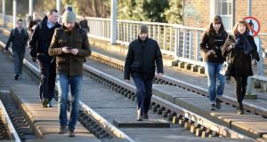 Luas Strike Commuters take to the tracks and walk along the Luas line at Ranelagh.Photograph: Eric Luke / The Irish Times