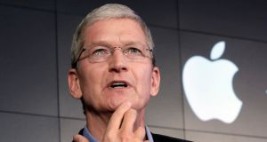 Apple chief executive Tim Cook: says the FBI, by asking Apple for help to unlock Syed Rizwan Farook's phone, is trying to 'build a back door to the iPhone'. Photograph: Richard Drew/AP