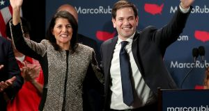 Republican presidential candidate Marco Rubio (right) and South Carolina govenor Nikki Haley (left) celebrate after Mr Rubio addressed supporters at a primary night event  in Columbia, South Carolina. Photograph: Getty