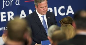 Jeb Bush reacts as he announces the suspension of his presidential campaign  on Saturday night  in Columbia, South Carolina. Photograph: Getty images