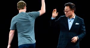 Founder and CEO of Facebook Mark Zuckerberg and president of mobile at Samsung DJ Koh during a presentation of the  Samsung Galaxy S7 and Samsung Galaxy S7 edge at the Mobile World Congress. Photograph: David Ramos/Getty Images