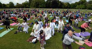 At a celebration of the International Day of Yoga, at St Anne's Park, Clontarf, in Dublin last summer. Photograph: Eric Luke