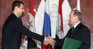 Russian president Vladimir Putin  with his Syrian counterpart Bashar al-Assad. Photograph: Sergei Chirikov/AFP/Getty Images
