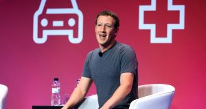 Mark Zuckerberg, chief executive officer of Facebook giving a keynote address at the Mobile World Congress: he urged the networks not to focus solely on faster connections for those who already had internet access. Photograph: Pau Barrena/Bloomberg