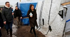 French judge Valerie Quemener tours a makeshift camp outside Calais, France, today. Photograph: Jerome Delay/AP Photo