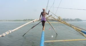 Day 218: Fisherman operating Chinese fishing nets at Fort Kochi in Kerela, India.