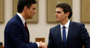 Socialist leader Pedro Sánchez (left) announcing a potential coalition agreement with Albert Rivera of Ciudadano. Photograph: Reuters/Juan Medina