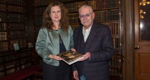 Grace Brady of the famine museum at Quinnipiac University, Connecticut, with  Robert Ballagh at the launch of 'In The Lion's Den, Daniel MacDonald, Ireland and Empire' by Niamh O'Sullivan at the RIA, Dublin. Photograph: Brenda Fitzsimons