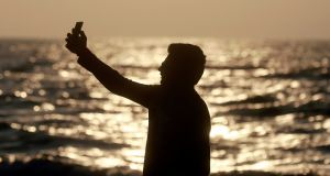 Mumbai has declared 16 areas no-selfie zones, following an increase in deaths linked to the photo craze. In this photo an Indian man takes a selfie in Mumbai's coastline.  Photograph: Rafiq Maqbool/AP