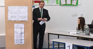 Exit poll shows Fine Gael support has slumped  to only 26.1 per cent. Taoiseach Enda Kenny prepares to cast his vote in a polling station at St Anthony's School in Castlebar, Co Mayo. Photograph: Clodagh Kilcoyne/Reuters