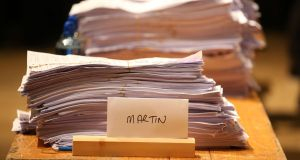Ballot papers stack up in favour of Fianna Fail Leader Micheal Martin during the general election 2016 count at the City Hall in Cork. Photograph: Chris Radburn/PA Wire